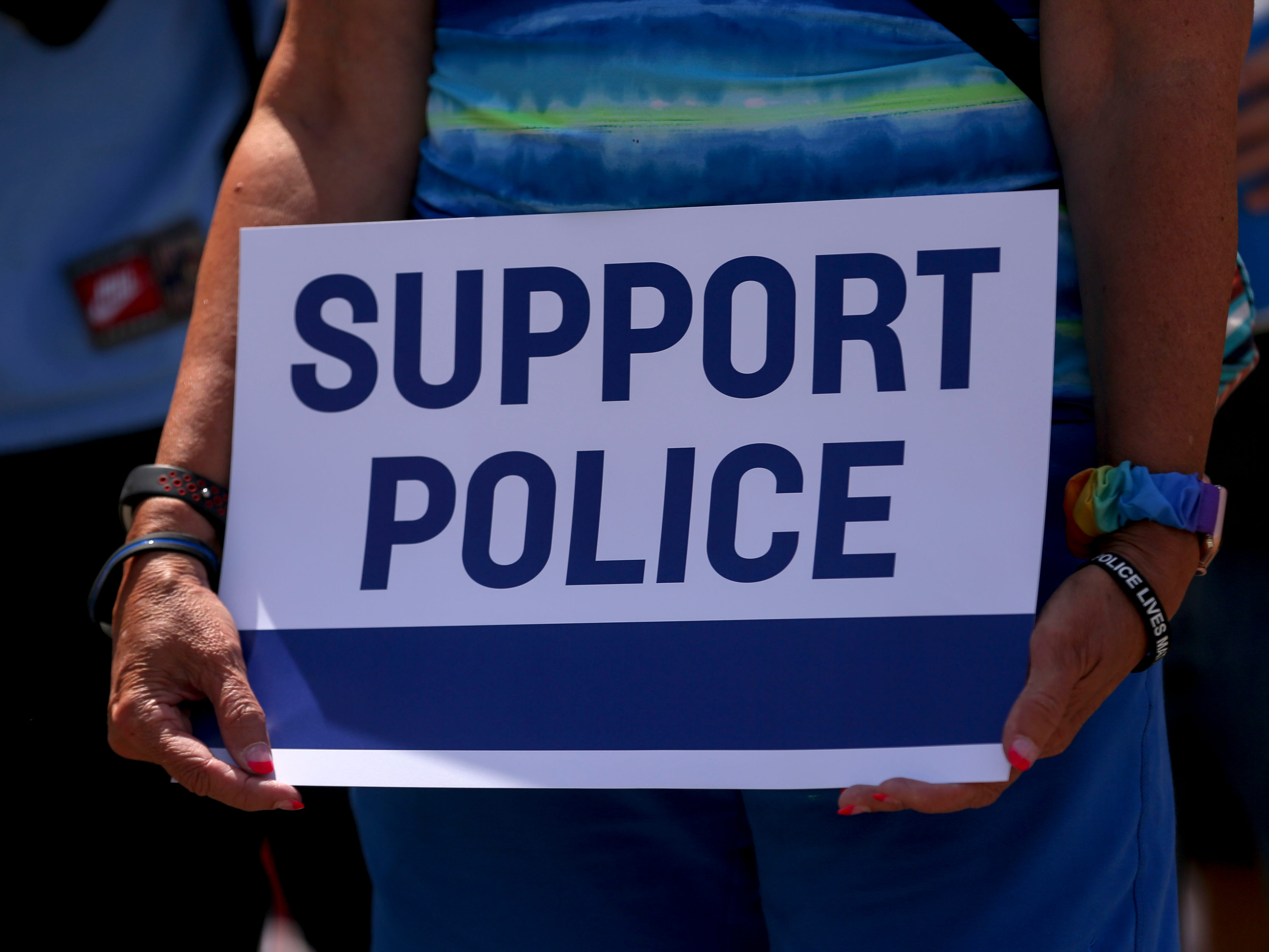 A demonstrator holds a sign during the Back the Blue rally at the Oregon State Capitol, in Salem, Oregon, on Saturday, July 11, 2020.